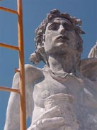 Irakli Chkhartishvili  is a young ,very hard working man from Georgia (Eastern Europe!). His 4.34 m statue made of grey marble showing :  HELIOS ... the ancient greek god of the sun
